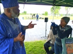 Griot & Master Storyteller Baba-C speaking with audience member